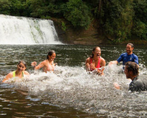 Students splashing by a waterfall Experiential learning in Nature
