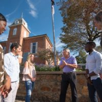 Steve woodsmall talking with students in downtown brevard